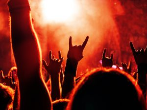Hands with horns during a heavy metal concert.