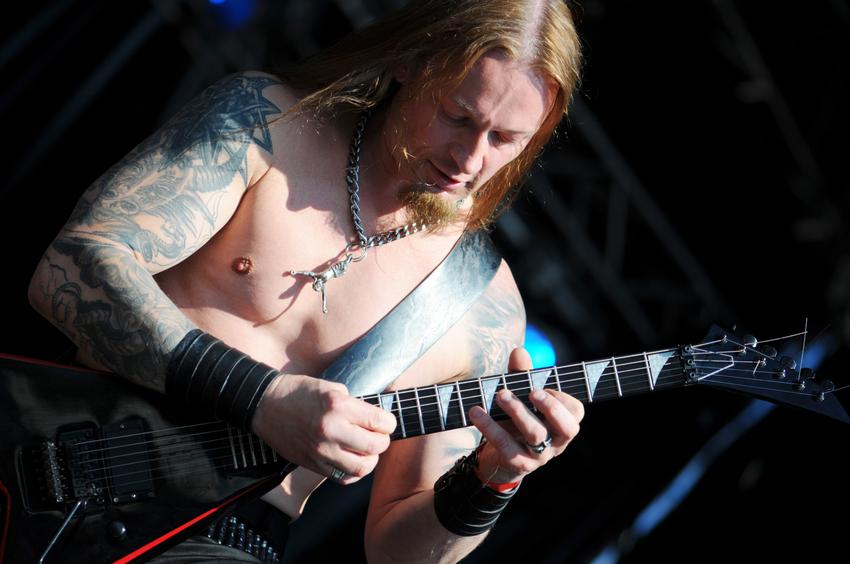 death metal guitarist on open air concert